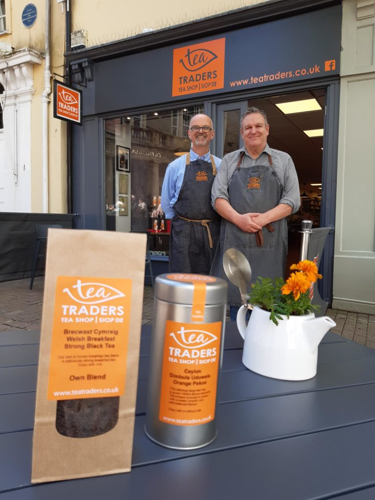 Paul and his partner, Nick, in front of their store, Tea Traders, in Carmarthen, Wales